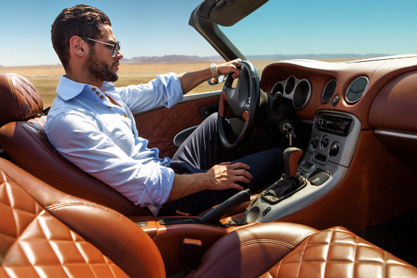 Handsome man driving in fancy car
